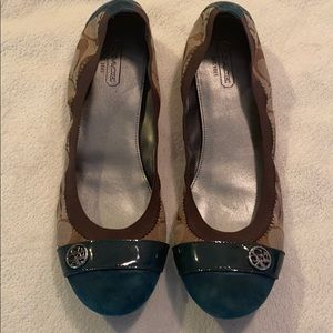 Coach brand flats with suede accent.